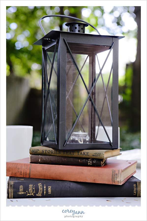 old books and lantern centerpieces for wedding reception