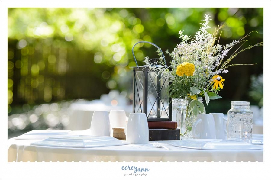 book centerpieces and wildflowers at backyard wedding