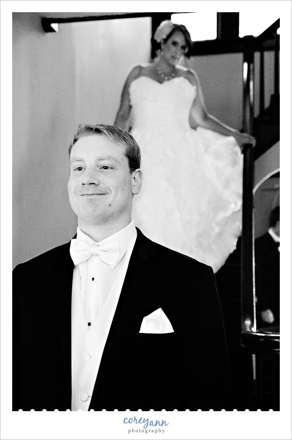 bride and groom doing first look on staircase at home in akron ohio