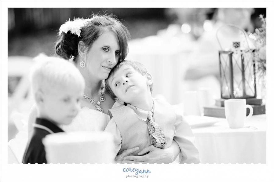 bride and son listening to poem being read during reception