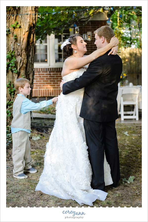 brides son cutting in during first dance