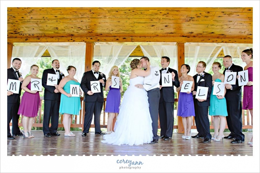 Multi Colored Bridal Party Holding Letters Of Married Name