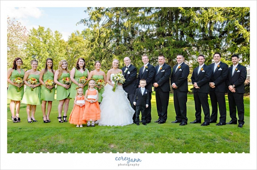 orange and green bridal party outside in akron ohio