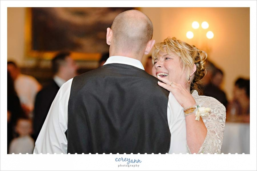mother son dance during wedding reception at portage country club