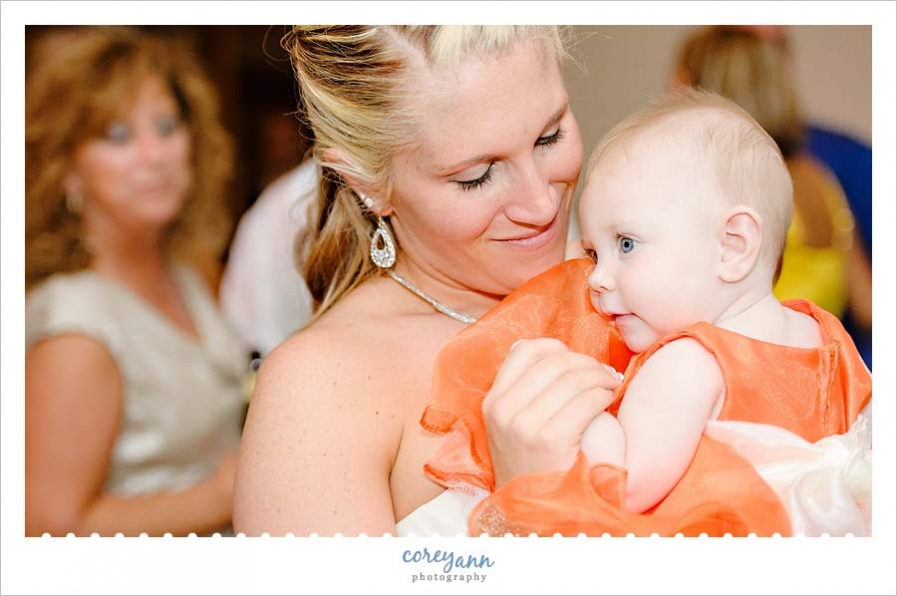 bride and baby daughter during wedding reception