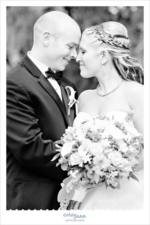 black and white portrait of bride and groom before wedding at portage country club
