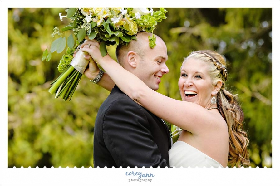 bride laughing during portraits outside on golf course