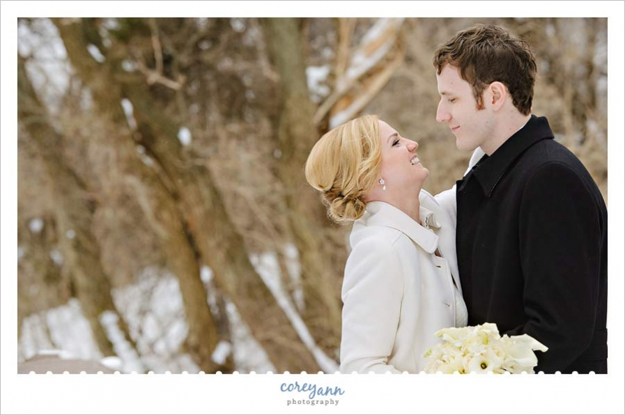 bride and groom outdoors in december for wedding pictures