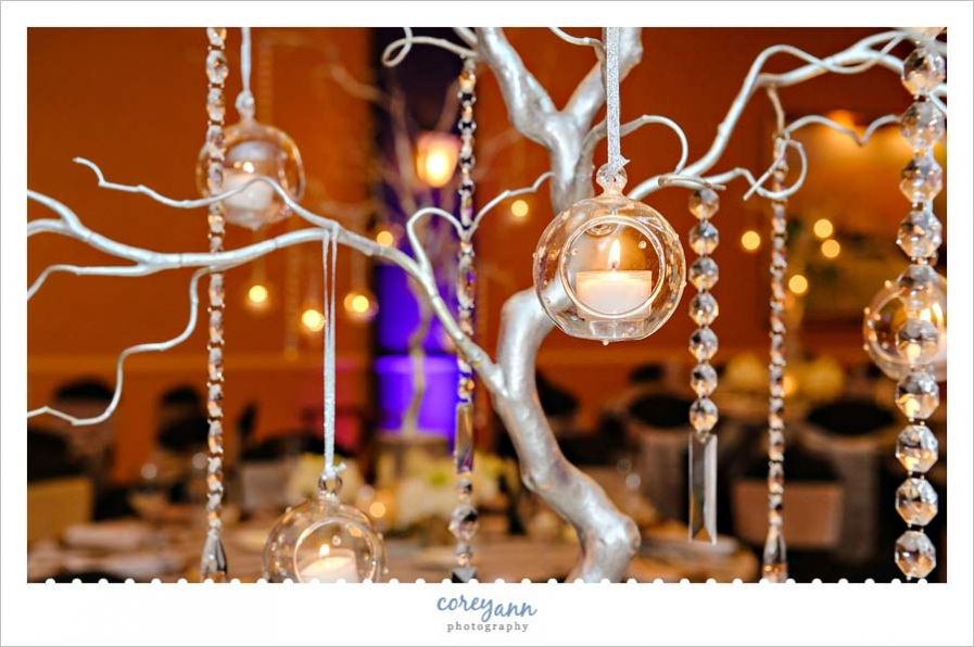 silver tree centerpiece with crystals and candle orbs