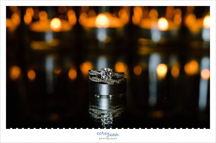 wedding rings with candles