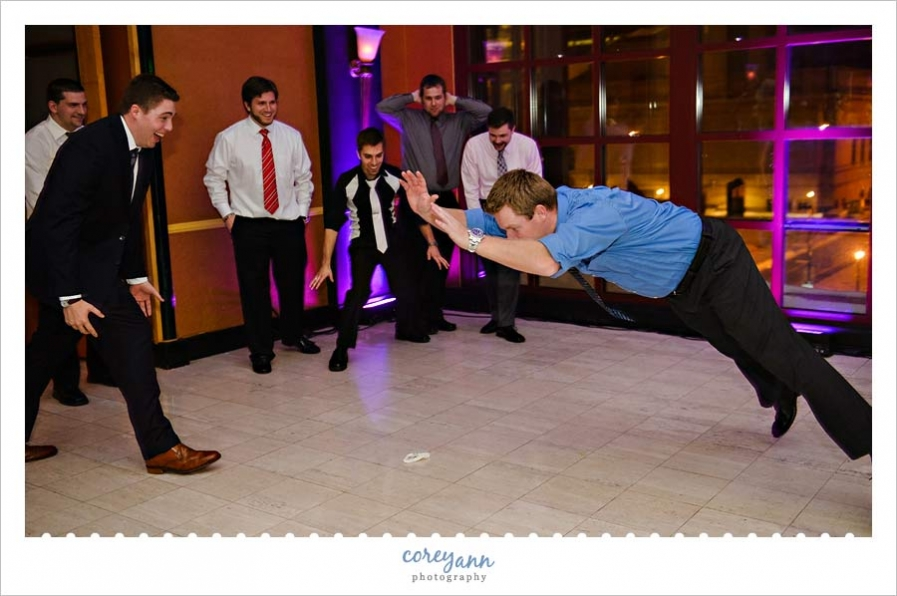 bachelors jumping over the garter after being tossed