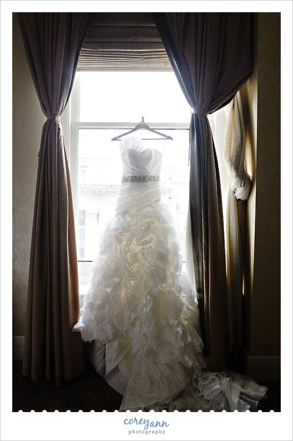wedding dress hanging in the window at the hyatt arcade