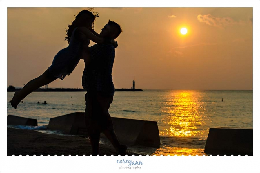 sunset engagement silhouette portrait in ohio on lake erie