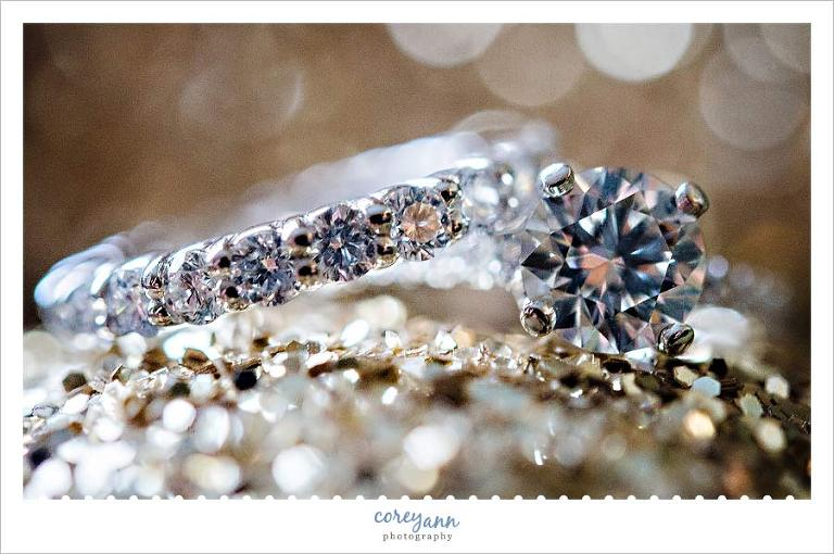 detail image of wedding rings on glitter shoes