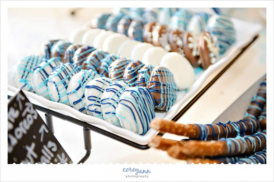 chocolate covered oreo wedding favors in blue and white