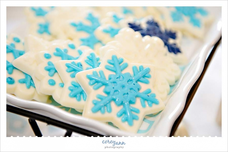 blue and white snowflake chocolate treats at winter wedding reception