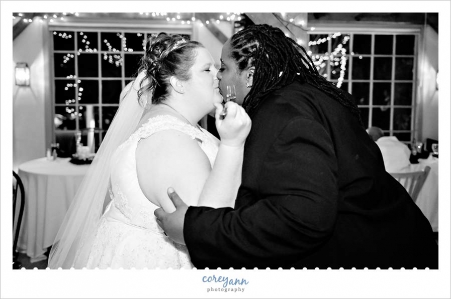 kissing after cake cutting at bittersweet farm wedding reception