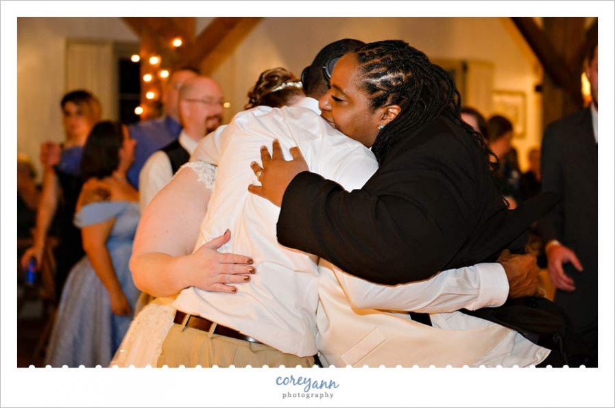 hugs after toast at wedding reception at bittersweet farms