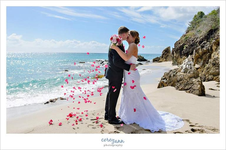 rose petals being thrown during wedding ceremony