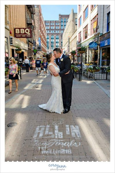 Wedding Picture Near All In CLE sign on East 4th Street