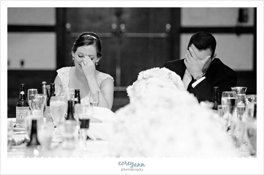Bride and groom laughing during toasts at wedding reception in northeast ohio