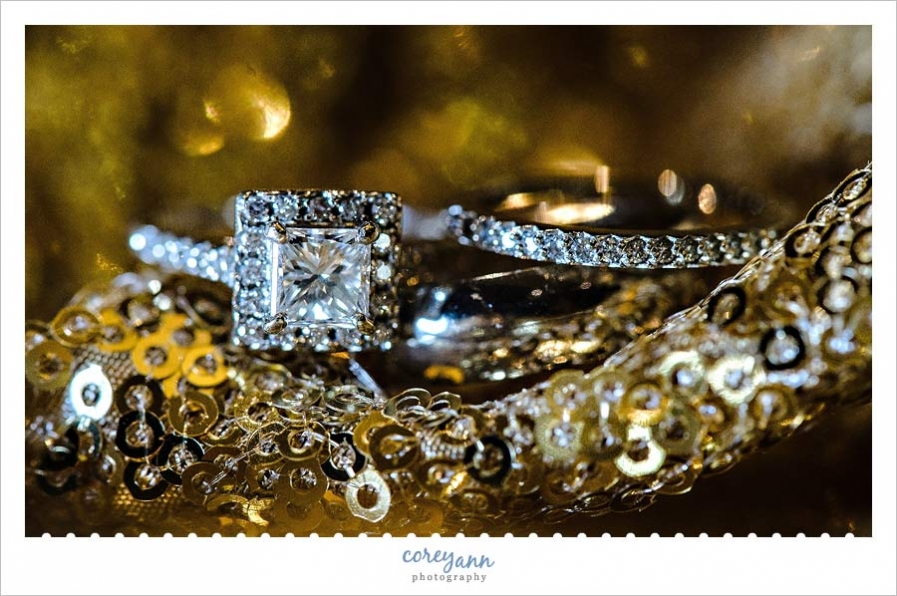 Wedding Rings on gold glitter tablecloth from event source rentals in Cleveland Ohio