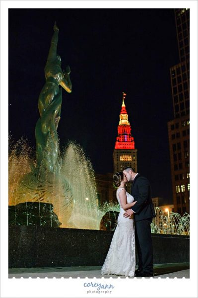 Night wedding photograph with cleveland cavaliers colors on terminal tower