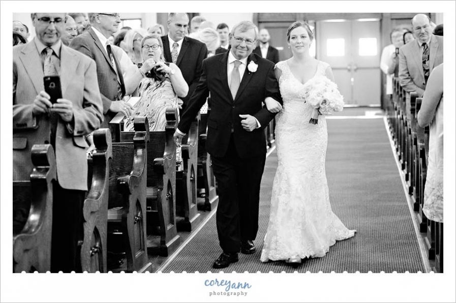 Bride walking down aisle at Holy Trinity in Avon