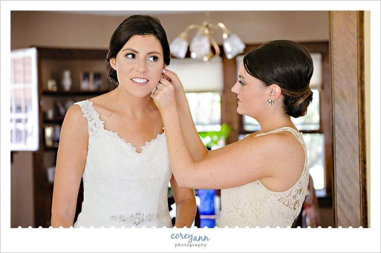 Maid of Honor and Bride getting ready for wedding
