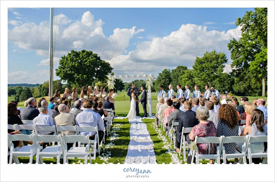 Outdoor wedding ceremony at brookside country club