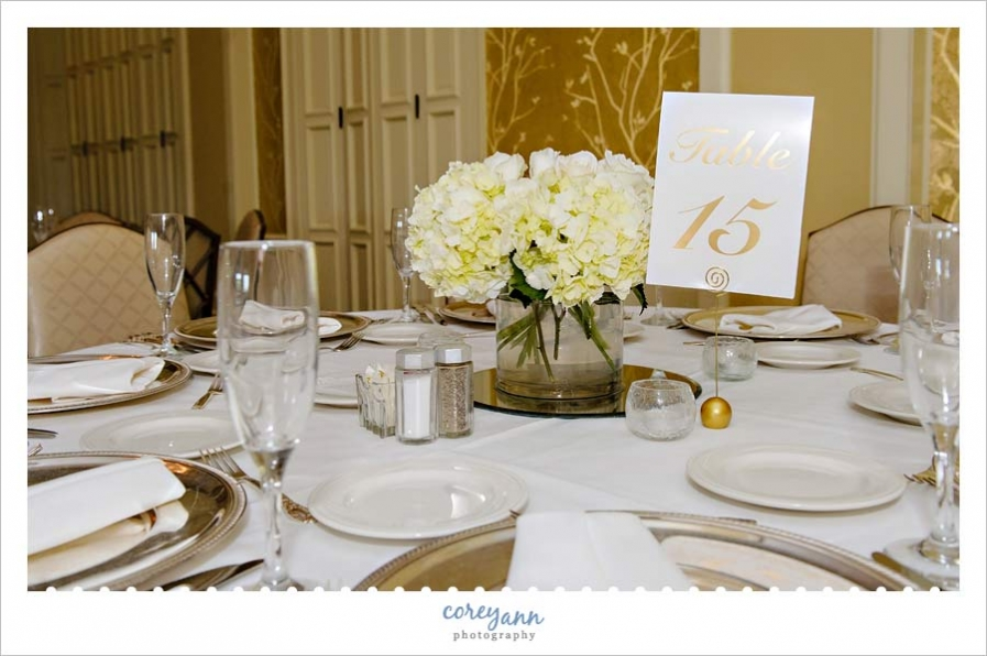 white and gold reception decor at brookside country club