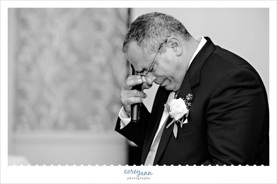 father of bride crying during toast at wedding