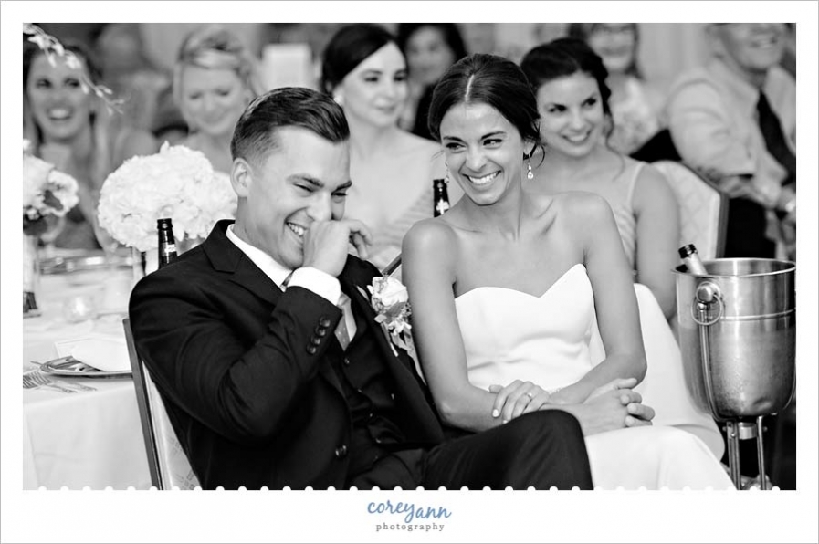Bride and Groom laughing during toasts