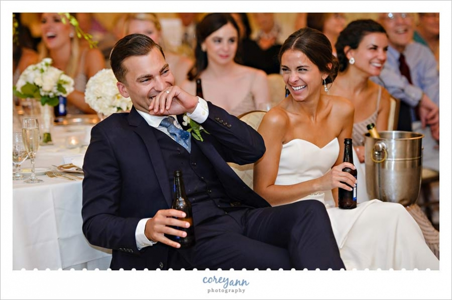 laughing during toasts at wedding reception