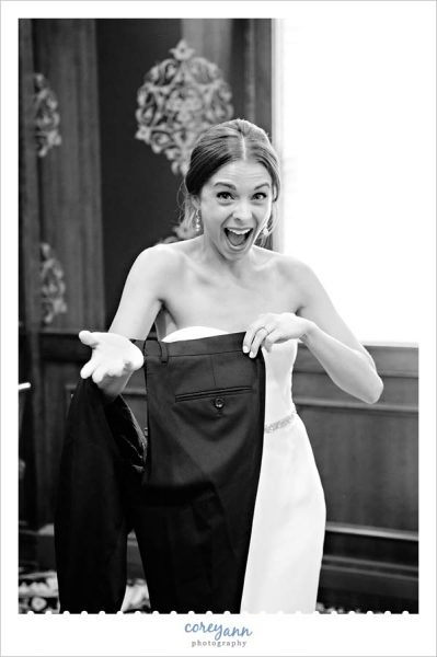 bride laughing while posing with ripped pants