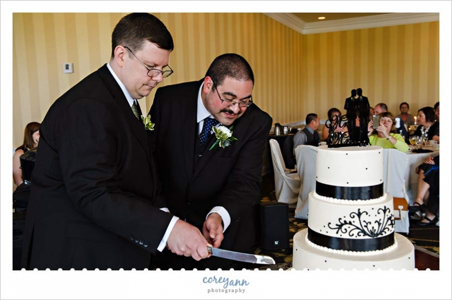 Cutting the Wild Flour Wedding Cake at Reception at the Crowne Plaza