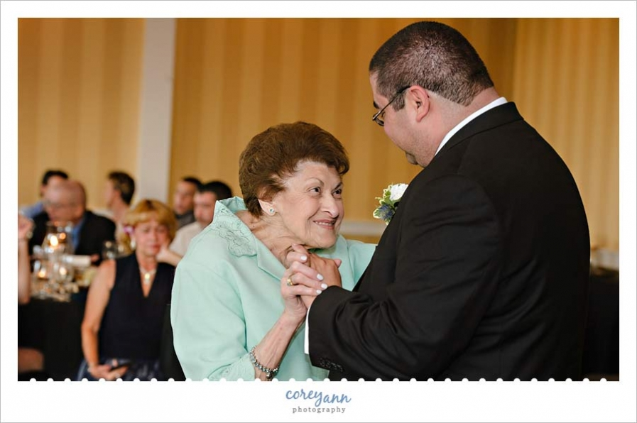 Grandmother and Son dance during wedding reception