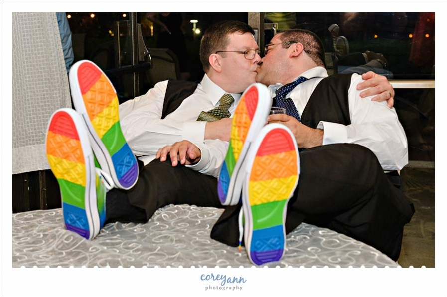 Wedding shoes showing off rainbow soles on table