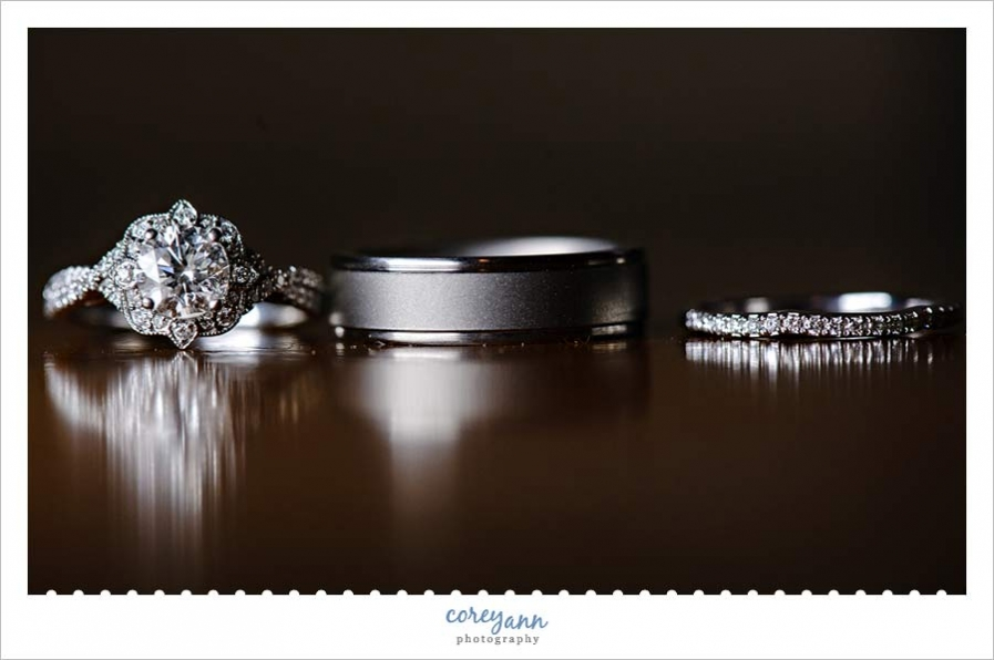 Wedding Rings on Table with Reflection
