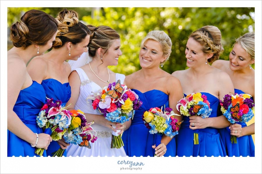 Bride and bridesmaids with multi colored bouquets