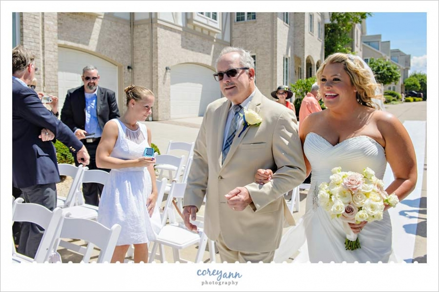 Bride and Father walking down aisle for outdoor wedding ceremony