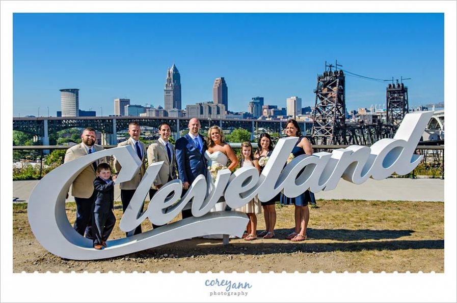 Wedding Party at Cleveland sign in Tremont