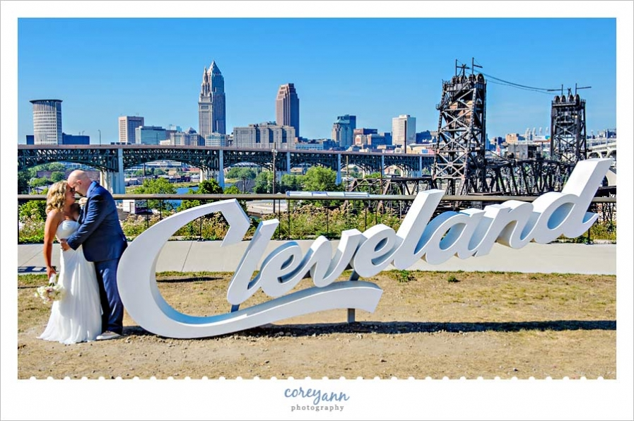 Bride and Groom pose near Cleveland sign in Tremont