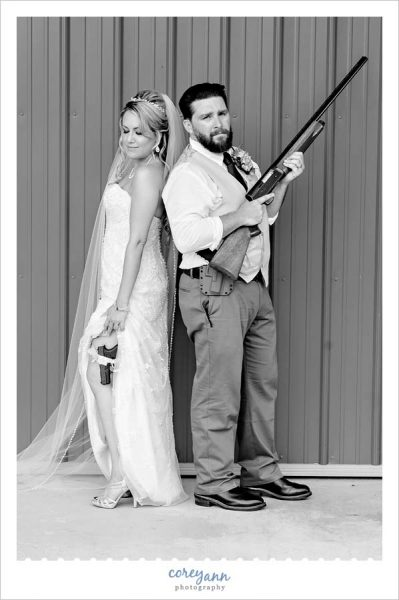 Bride and Groom pose with guns