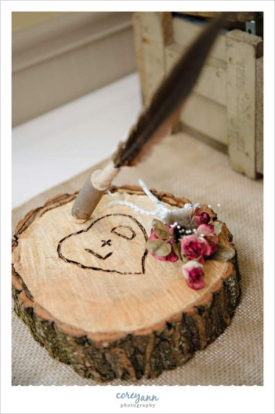 Hand carved guestbook pen holder at wedding