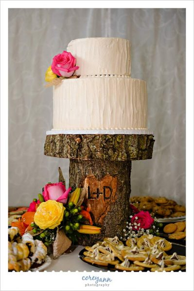 wedding cake on custom carved wood stand