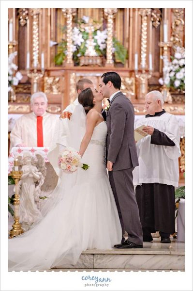 First Kiss after wedding ceremony at St John Cantius Roman Catholic Church in Tremont