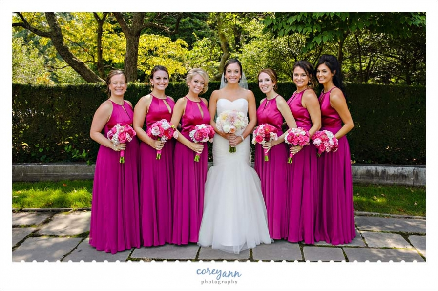 Bride and bridesmaids with long pink gowns