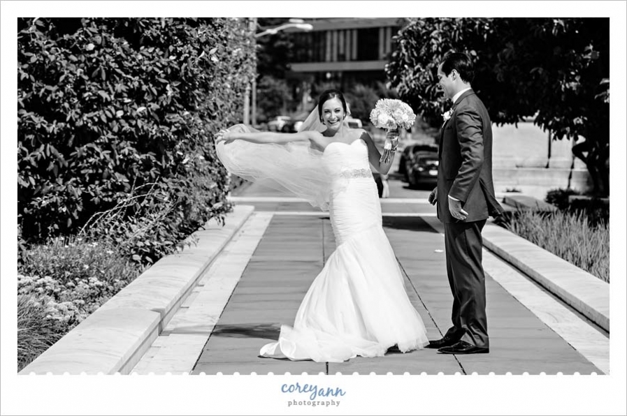 Bride laughing after veil blows away