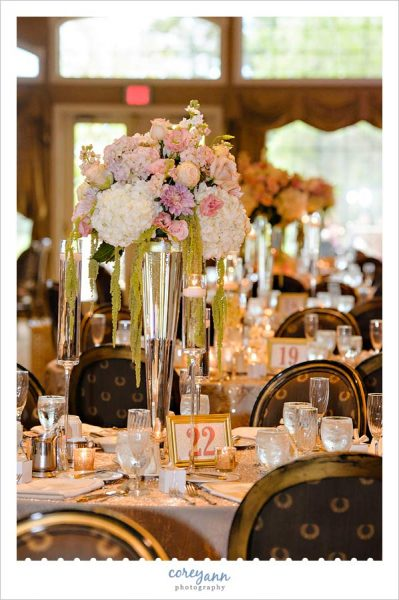 Tall floral centerpiece by Pink Petals Florist at Weymouth Country Club